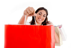Portrait of woman showing shopping bags Stock Photos