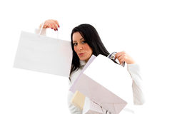 Portrait of woman showing shopping bags Royalty Free Stock Photography