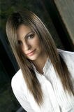 Portrait of woman with silky hair. Portrait of bautiful young woman with silky hair Stock Photo