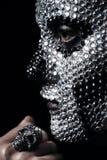 Portrait of woman in silver rhinestones. In studio Royalty Free Stock Photos