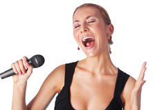 Portrait of woman singing with a microphone. Cute portrait of woman singing with a microphone isolated in white background Stock Photo