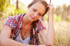 Portrait Of  Woman Sitting In Countryside In Field Of Grass Stock Images
