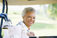 Portrait Of Woman Sitting In A Golf Cart Royalty Free Stock Photography