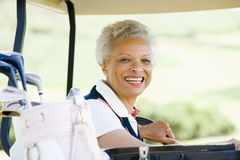 Portrait Of Woman Sitting In A Golf Cart Stock Photo