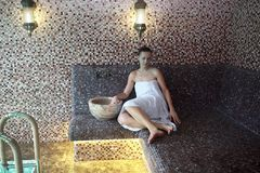 Woman sitting in hammam Stock Photo