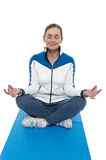 Portrait of a woman sitting in a lotus position Royalty Free Stock Photo