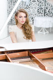 Portrait of woman sitting at the piano Stock Image
