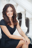 Portrait of a woman sitting on the steps Royalty Free Stock Image