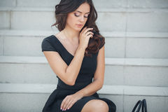 Portrait of a woman sitting on the steps Stock Photo