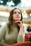 Portrait of woman sitting in theatre salon. Portrait of pretty woman sitting in theatre salon and watching show Royalty Free Stock Photography