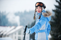 Portrait of a woman at a ski resort Royalty Free Stock Images