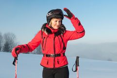 Portrait of woman-skier in red jacket Stock Photography