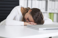 Portrait of woman sleeping at work royalty free stock photos