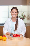 Portrait of a woman slicing a pepper Royalty Free Stock Photo