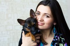 Portrait of woman with small dog. Portrait of beautiful woman with small dog Royalty Free Stock Images