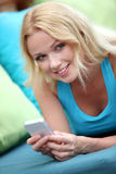 Portrait of woman with smartphone Royalty Free Stock Image