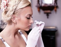 Portrait of woman smelling a bottle of perfume Stock Photography