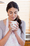 Portrait of a woman smelling a cup of coffee Royalty Free Stock Images