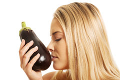 Portrait of a woman smelling eggplant Stock Photo