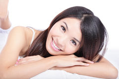 Portrait of woman smile face lying on bed stock images
