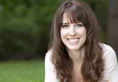 Portrait of a woman smiling at the camera Royalty Free Stock Photography