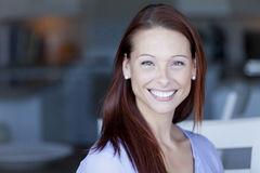 Portrait Of A Woman Smiling. At The Camera. Redhead Royalty Free Stock Images