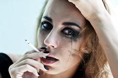 Portrait of the woman smokes Stock Photography
