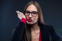 Portrait of woman smudging lipstick Stock Photos