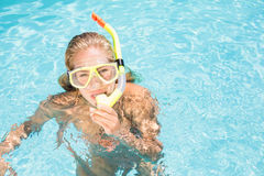 Portrait of woman with snorkel gear swimming in pool Stock Image