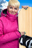 Portrait of woman with snowboard Royalty Free Stock Images