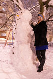 Portrait of a woman with snowman Royalty Free Stock Images