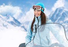 Portrait of woman on snowmobile Royalty Free Stock Photo