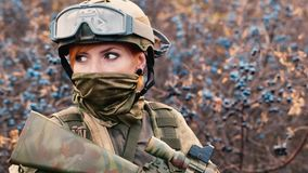 Portrait of woman soldier with a weapon. A woman soldier with a weapon stock video