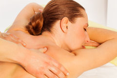 Portrait of woman in spa salon getting massage Royalty Free Stock Photo
