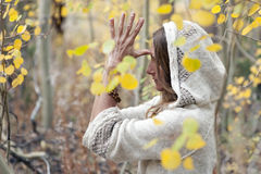 Fall Yoga Woman. Portrait of a woman in spiritual yoga meditation outdoors in the woods Stock Image