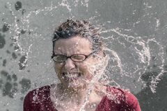 Portrait of woman splashed with water
