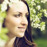 Portrait of woman with spring flowers Stock Photo