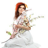 Portrait of woman with spring flowers on white Royalty Free Stock Photo