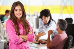 Portrait Of Woman Standing In Busy Creative Office Royalty Free Stock Photography