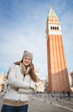 Portrait of woman standing in front of Campanile di San Marco Stock Images
