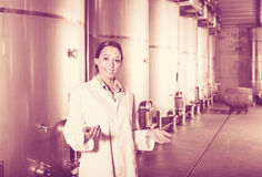 Portrait of woman standing on wine factory in secondary fermenta Stock Photo