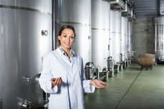 Portrait of woman standing on wine factory in secondary fermentation section Stock Photo