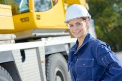 Portrait woman stood beside crane Royalty Free Stock Images