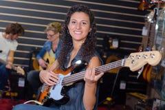 Portrait woman strumming guitar Royalty Free Stock Photography