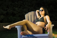 Portrait of a woman in summer time. Portrait of a woman sitting on a chair Stock Photo