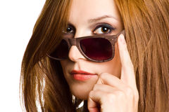 Portrait of a woman in sunglasses. Portrait of a woman in sunglasses on white background Royalty Free Stock Image