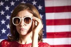 Portrait of  woman with sunglasses against american flag Stock Images