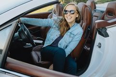 Portrait of woman in sunglasses sitting in a car Royalty Free Stock Images
