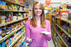 Portrait Of Woman In Supermarket With Shopping List Royalty Free Stock Images