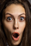 Portrait woman of surprised caucasian isolated on gray backgroun Royalty Free Stock Photography
